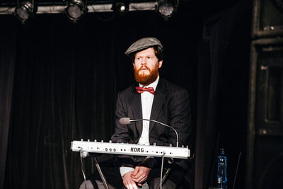 Steve Meagher (Marr) playing music in You'll Never Guess Where I Hid the Cheese, Sydney Fringe 2017