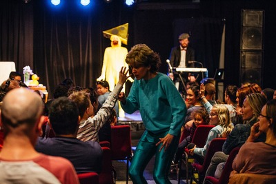 Bobbi (Alicia Gonzalez) getting help from the audience in You'll Never Guess Where I Hid the Cheese, Sydney Fringe 2017
